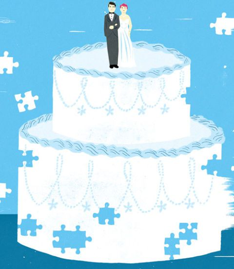 सफेद wedding cake on a blue background with a couple cake topper