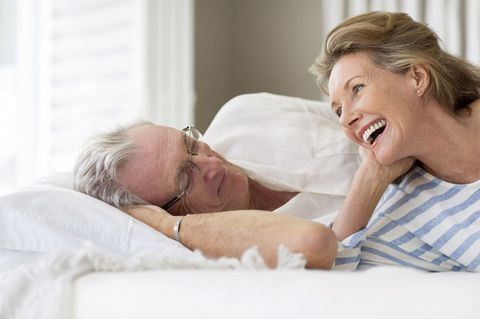 זוּג in their 60s in bed
