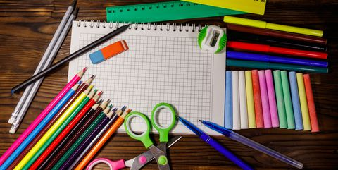 सेट of school stationery supplies on wooden desk. Back to school concept